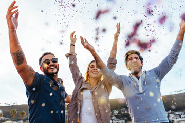 Millennial enjoying at party with confetti