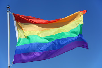 The rainbow flag - LGBT symbol - for gay, lesbian, bisexual or transgender relationship, love or sexuality