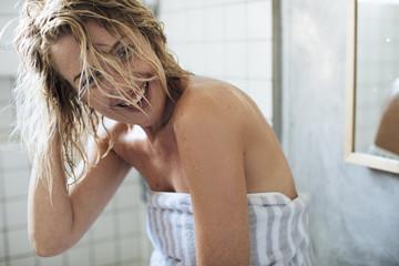 Portrait of Sexy Woman in Bathroom