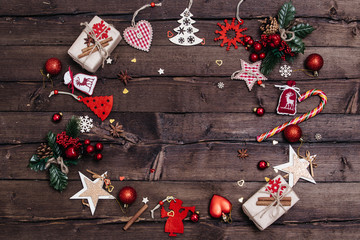 Christmas background with decorations, xmas tree and gift boxes on wooden board.