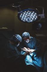 Surgeons doing a foot surgery.