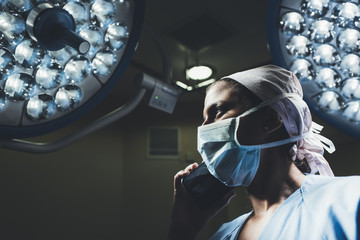 Surgeon with a mobile phone in the operating room
