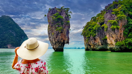 Woman tourist looking at James Bond island in Thailand