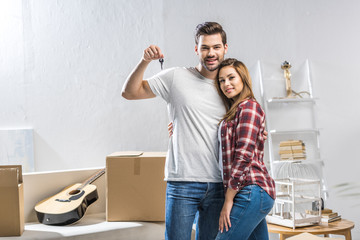 attractive couple showing house key