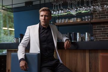 Stylish businessman posing in ba