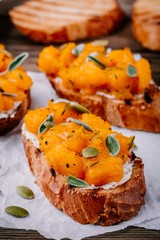 Pumpkin and goat cheese toasts with sage and pumpkin seeds