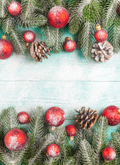 Christmas banner with green tree, red and white handmade felt decorations on white wooden textured background