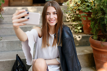 young beauty woman make selfie for self smartphone