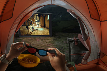 View from the tourist tent to the screen with a gangster movie