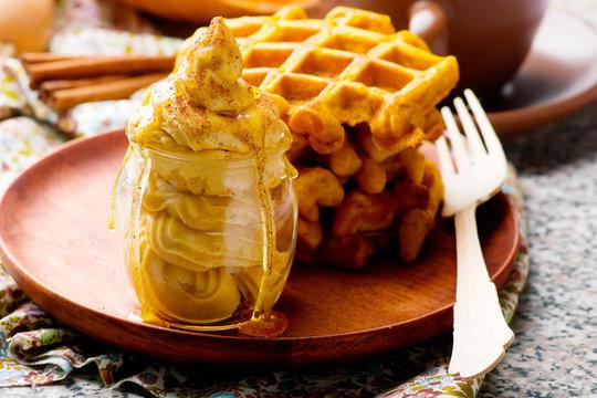whipped pumpkin honey  butter in glass jar.