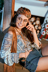 Smiling bohemian girl in glasses
