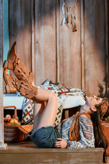 girl in boho style lying on floor