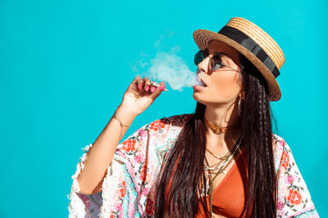 girl smoking cigarette and exhaling smoke