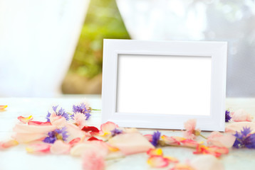 White picture frame on wooden table