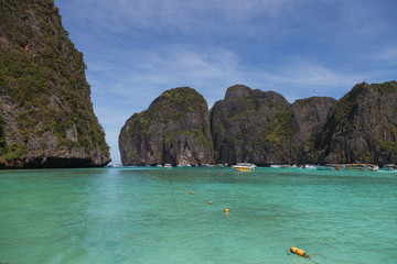 Traditional wooden boat in a picture perfect tropical Maya bay on Koh Phi Phi Le Island, Thailand, Asia