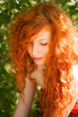 Beautiful photo of a pretty redhead girl with curly hair