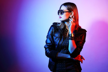 Wall Mural - Fashion portrait of young elegant woman in sunglasses.