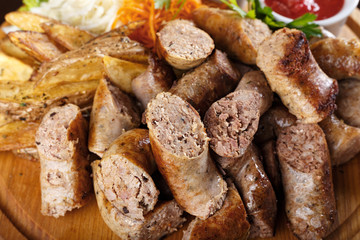 Assorted sausages with sauce