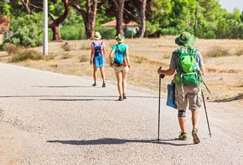 Multinational group of three tourists exploring nature of Turkey, while travelling by Lycian Way in Chirali