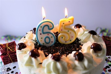 An image of a birthday cake with candle - 65
