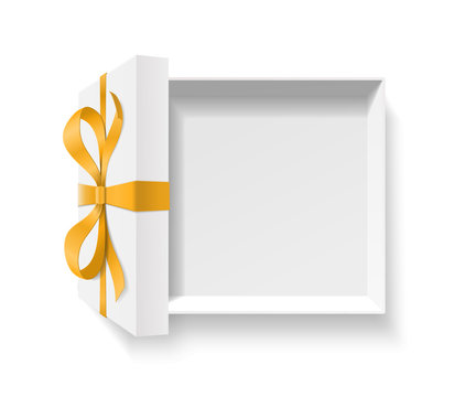 Empty open gift box with gold color bow knot and ribbon isolated on white background.