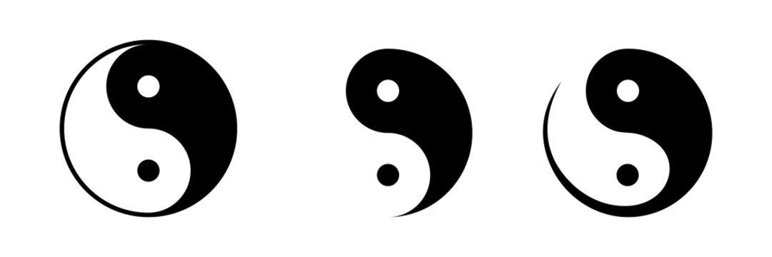 Vector set of black and white yin and yang symbols isolated on a white background.
