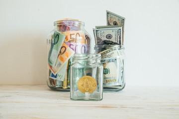 money in jar euro dollars bitcoin