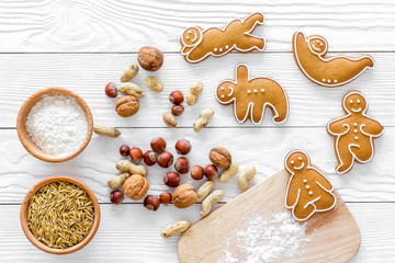 Make gluten free healthy food. Yoga asanas cookies near desk, flour and wheat on white background top view copyspace