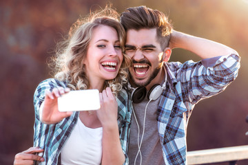 Happy adorable lovers posing for selfie shot.