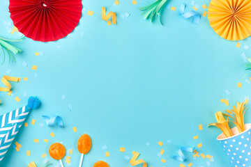 Celebration pattern with various party confetti on blue background. Flat lay