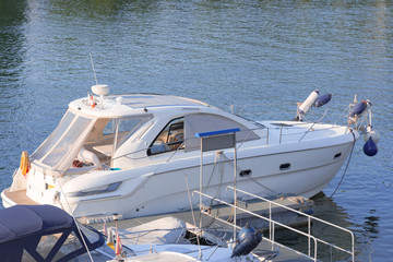White pleasure motorboat at the pier