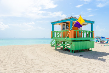 Wall Murals Caribbean Miami South Beach, lifeguard house in a colorful Art Deco style at sunny summer day with the Caribbean sea in background, world famous travel location in Florida, USA