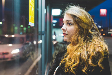 portrait of young beautiful woman outdoor looking sideway - thinking future, getting away from it all concept