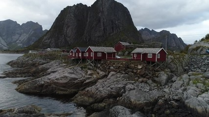 Wall Mural - Traditional red rorbu cottages in Hamnoy fishing village on Lofoten islands