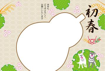 犬と稲穂とひょうたんの写真フレームの戌年の年賀状