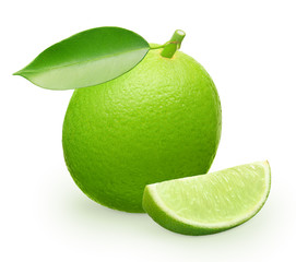 Whole fresh lime fruit with green leaf and slice