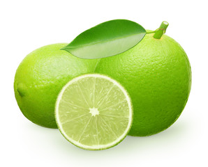 Lime fruit with green leaf next to lying and half