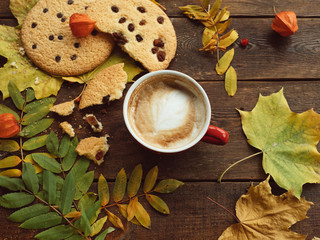 Autumn harvest. Fall leaves and berries assortment background. Hot beverage concept