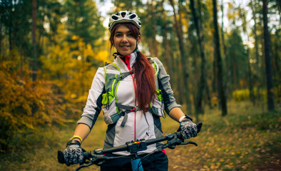 Image ofa girl in helmet riding bicycle