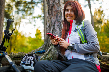 Picture of girl with cellular phone in autumn forest