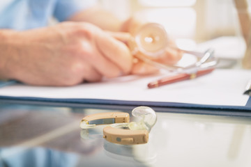 Doctor audiologist and hearing aid