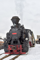 Running wood-burning locomotive of Mocanita ( Bucovina, Romania).