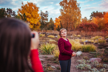 Photographer takes a picture of a middle-aged woman