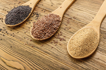 Three tablespoons of seed. Vegetarian food. Raw flax seeds, sesame and amaranth. Rustic style.