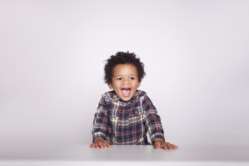 Portrait of a cute smiling african american little boy in checkered shirt  isolated on white background.