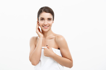 Beauty & Skin care concept -Beautiful caucasian young woman wearing towel after shower.