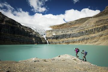 People walking by lake in Bow Glacier, Banff, Alberta, Canada