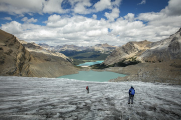 People walking by lake in Bow Glacier, Banff, Alberta, Canada
