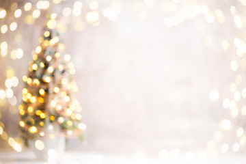 Defocused christmas tree silhouette with blurred lights.