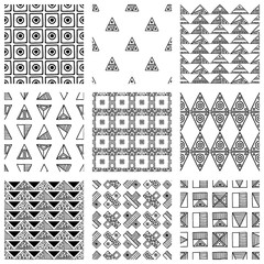 Seamless vector pattern. Black and white geometrical background with hand drawn decorative tribal elements. Print with ethnic, folk, traditional motifs. Graphic vector illustration.